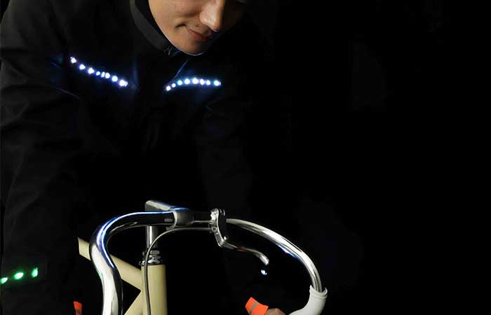 LED illuminated clothes from Lumenus on a cyclist