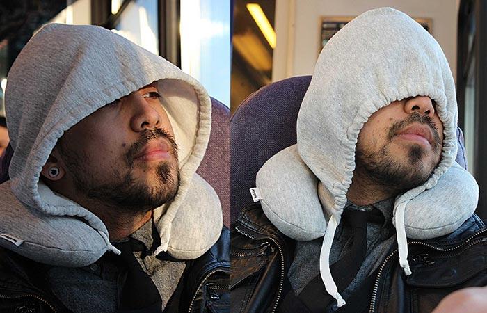 A man wearing Travel Hoodie Pillow