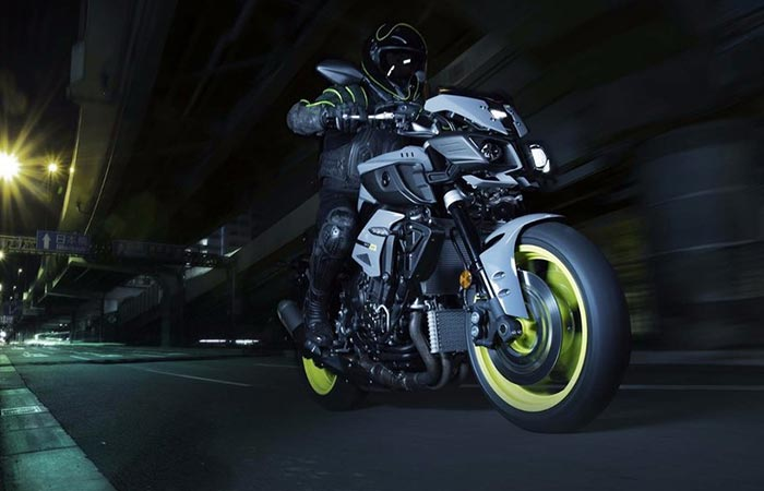 Guy riding MT - 10 in the night.