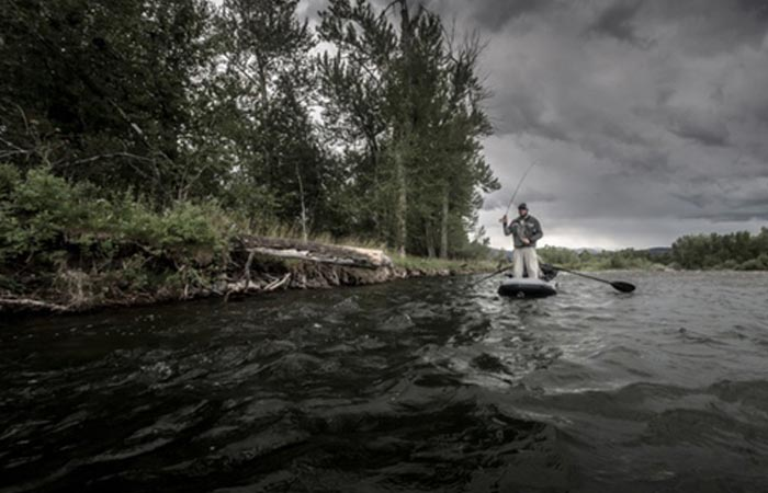 A man in Flycraft Stealth boat on a river