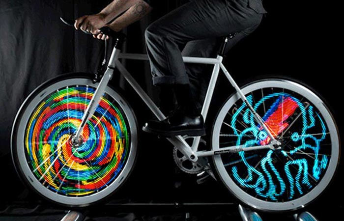 A bicycle with LED Bike Wheel Lights attached to the wheels, ridden, simulation.