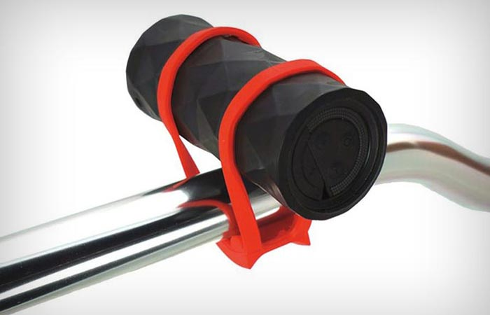 The Buckshot Bicycle speaker attached to a metal pole. White background.