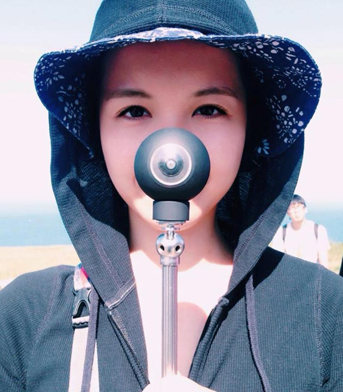 Girl captured while holding a Luna 360.