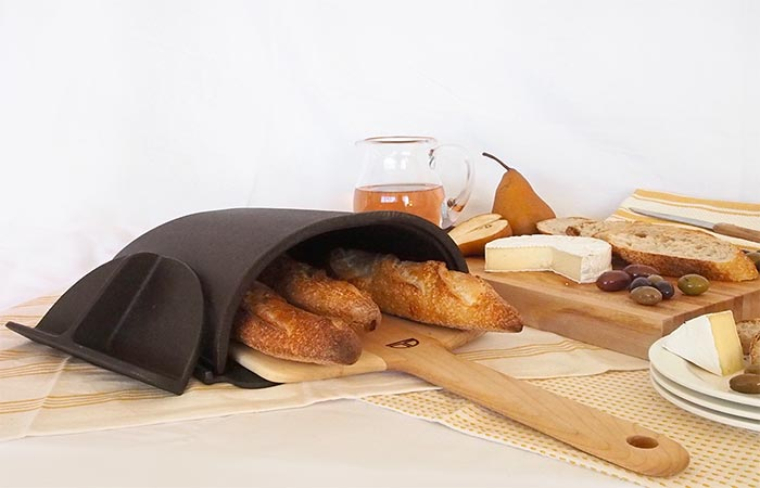 The Fourneau Bread Oven Placed On A Table With Food