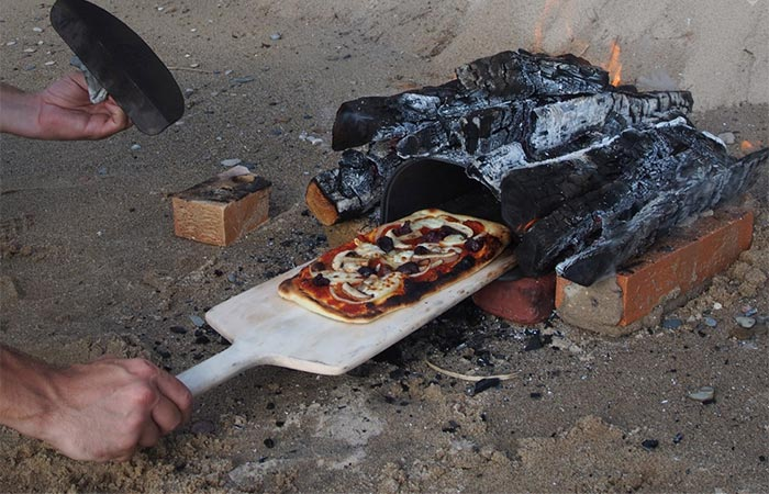 The Fourneau Bread Oven on camp fire.