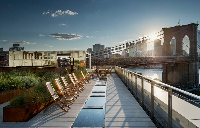 Brooklyn Apartment Building With Communal Roof Garden Wooden Chairs