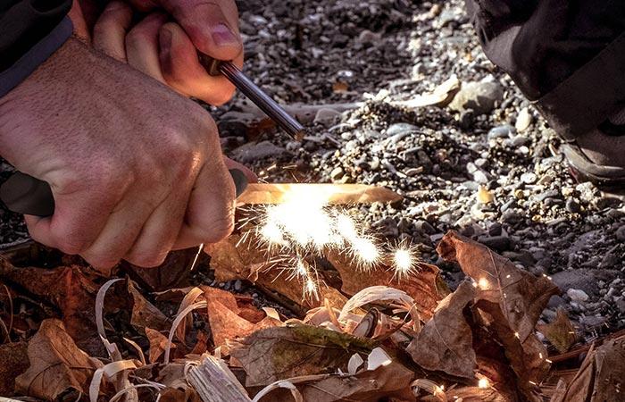A knife starting a fire.