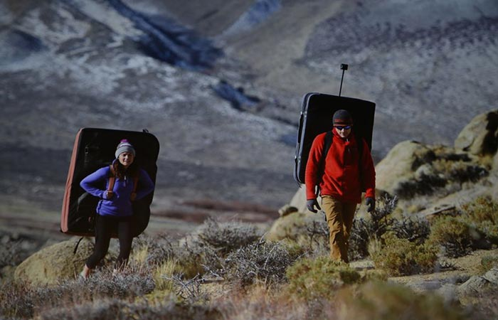 A man and a woman photographed from the distance while using the Nikon camera.