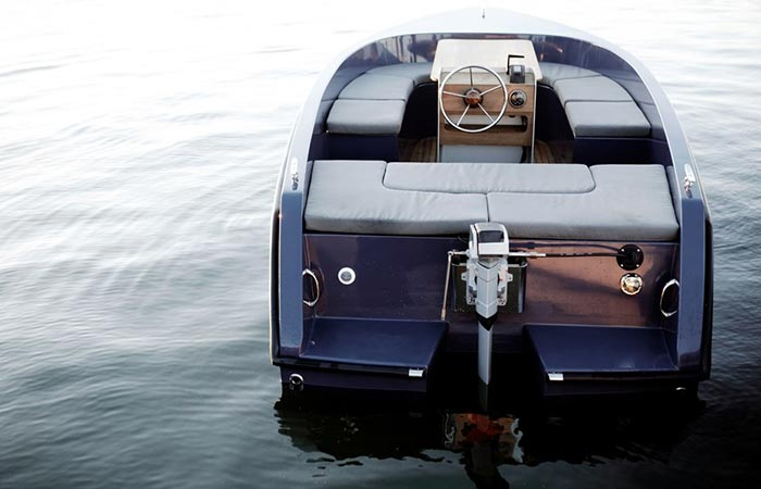 RAND Electric Picnic Sport Boat in the water, a rear view.