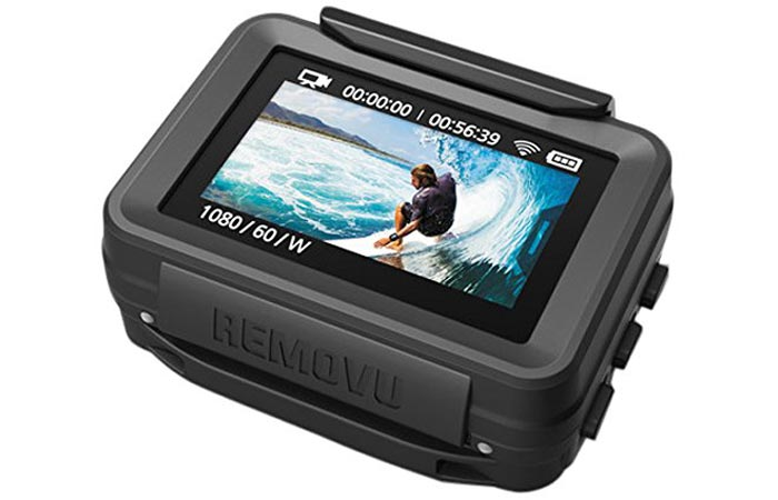 Removu P1 GoPro Live Viewer, tilted, on a white background, with an image of a person surfing on the screen.