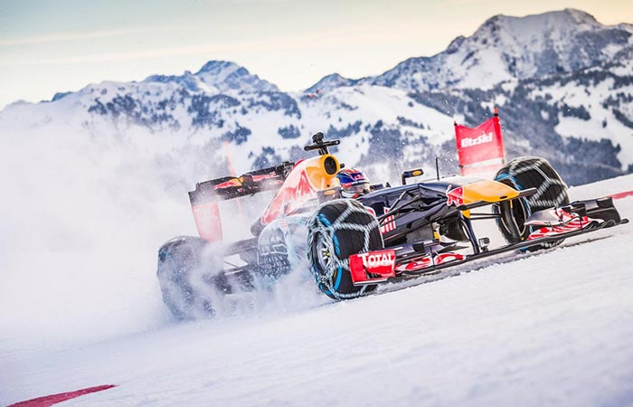 F1 car photographed from the side while racing.