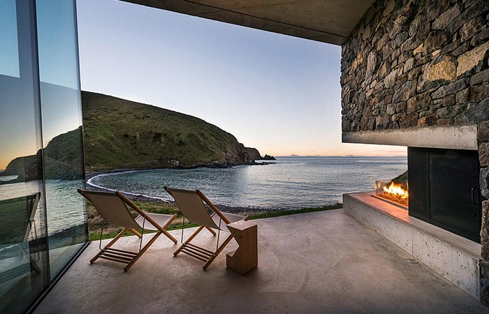 Seascape Retreat on a South Pacific Cove, the terrace with two chairs at sundown.