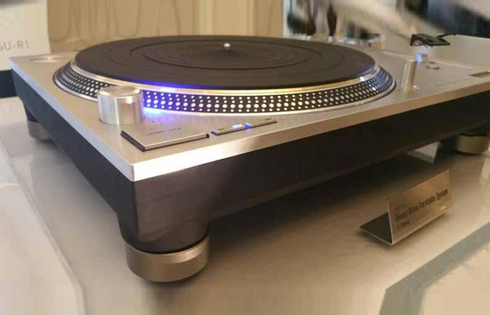 Technics SL-1200GAE on a table, tilted view.