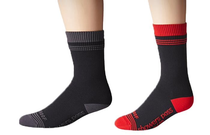 Showers Pass Waterproof Crew Socks , black/grey, and chili red, on a white background, side view, worn.