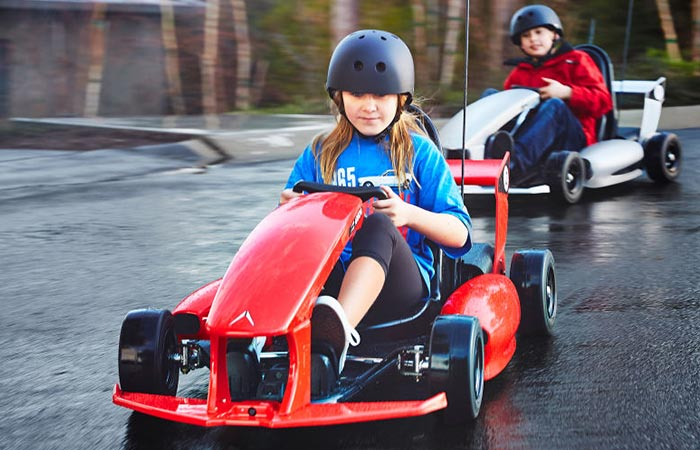 A boy and a girl captured while driving the Smart-Kart.
