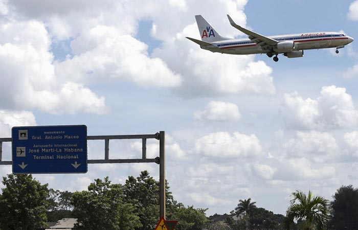 An American Airlines plane in the sky near the Airport Nacional in Havana, Cuba.