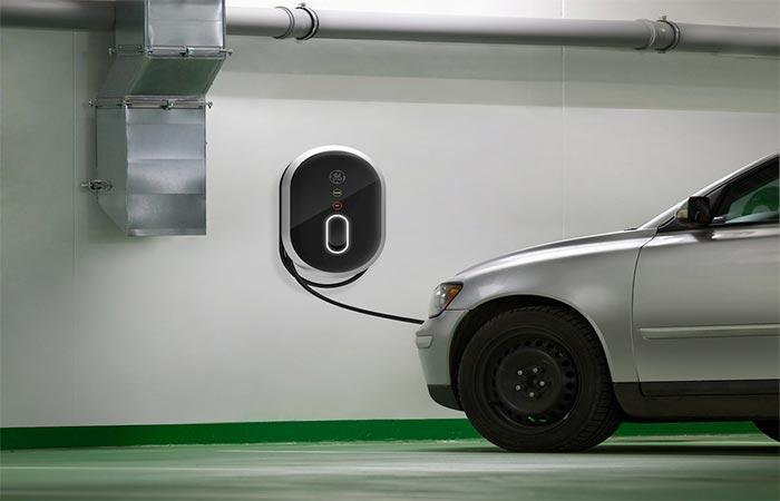 An electric car charging via GE WattStation