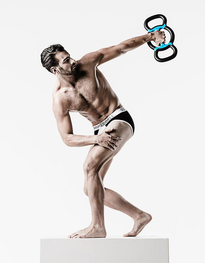 Man holding a device in a famous pose.