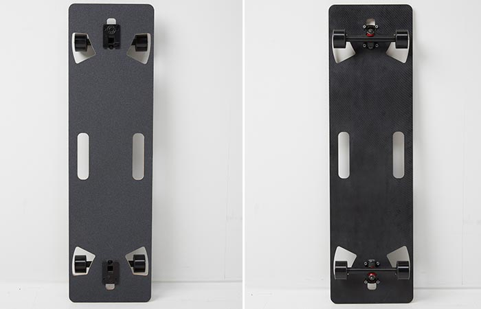 Lo-Ruiter Longboard leaned up against the wall, front and back view.