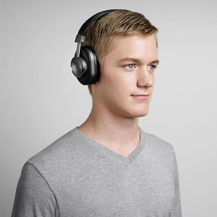 A man captured wile listening to music with M&D headphones.
