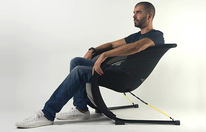 A Guy Sitting On Suzak Chair