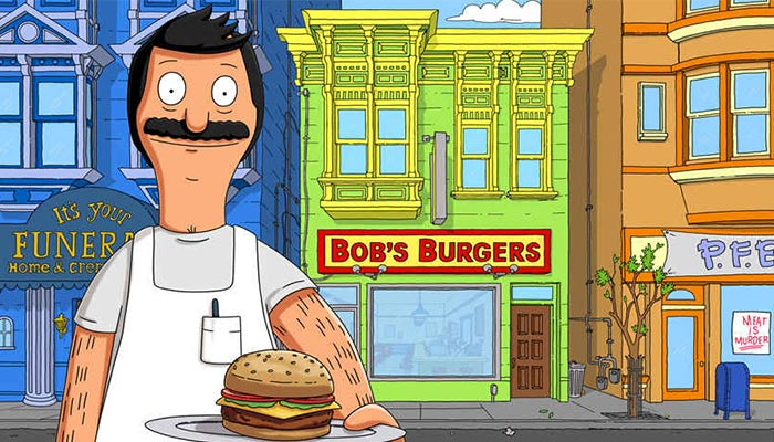Bob in front of the Bob's Burgers restaurant.