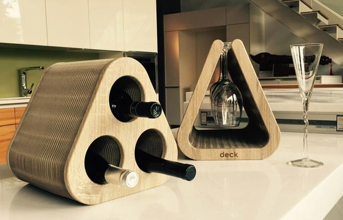 The Deck - Flexible Wine And Goblet Holder on the kitchen counter filled with three bottles and a few glasses