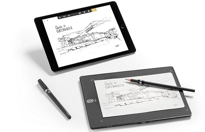 A tablet and The Slate - Smart Drawing Pad with two pens, on a white background.
