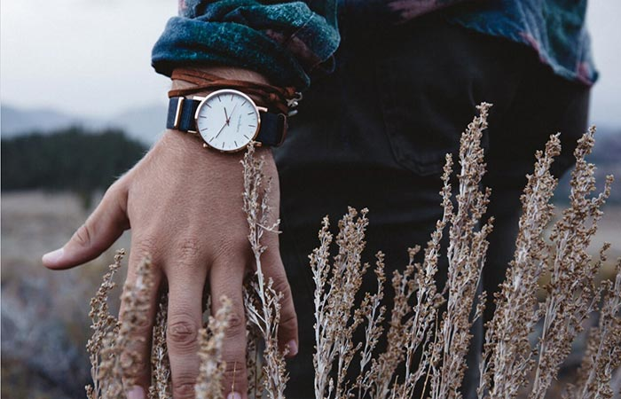 Thread Etiquette Classic Timepiece on the hand of a person in a wheat field.