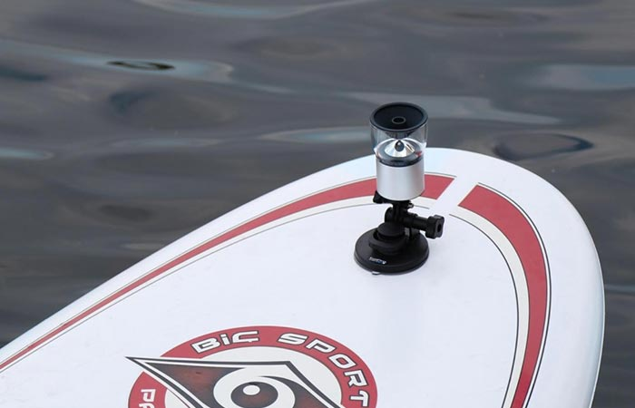 Camera mounted on a surfboard.