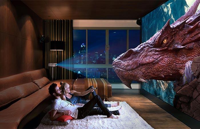 A Couple Watching A 3D Dragon Image Using JmGO G1