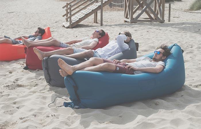 Four Guys On A Beach On KAISR