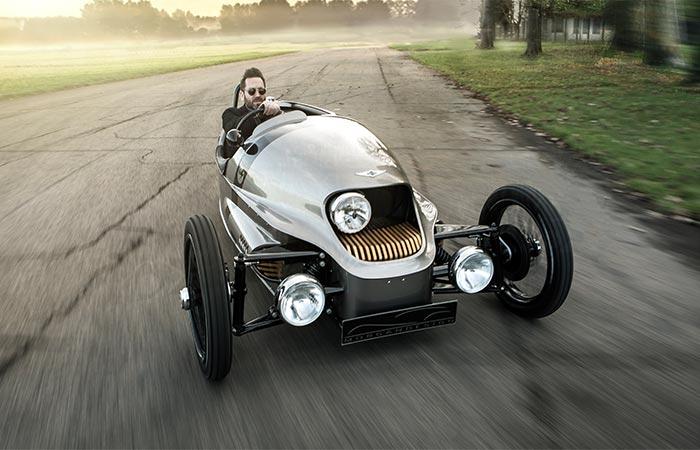 A Guy Driving Morgan EV3 Electric Car