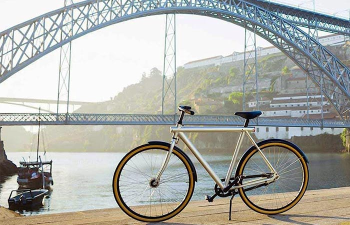 Grey VanMoof Electrified S Next To A River