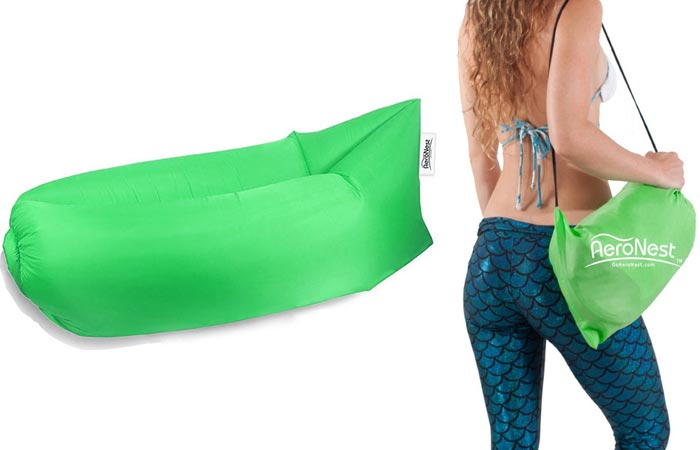 The AeroNest Air Lounger inflated and a woman carrying a deflated and packed up AeroNest in its carry-bag