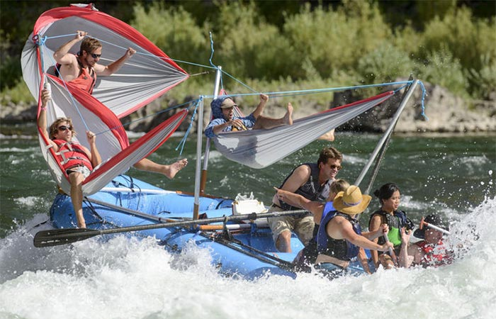 Five People On A Hammocraft In Water With Waves