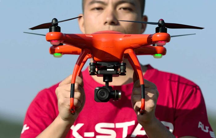 Man holding the X-Star Drone