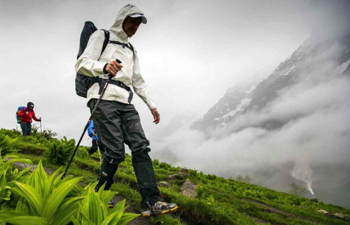A Guy Hiking In Columbia Outdry Extreme Eco Rain Jacket