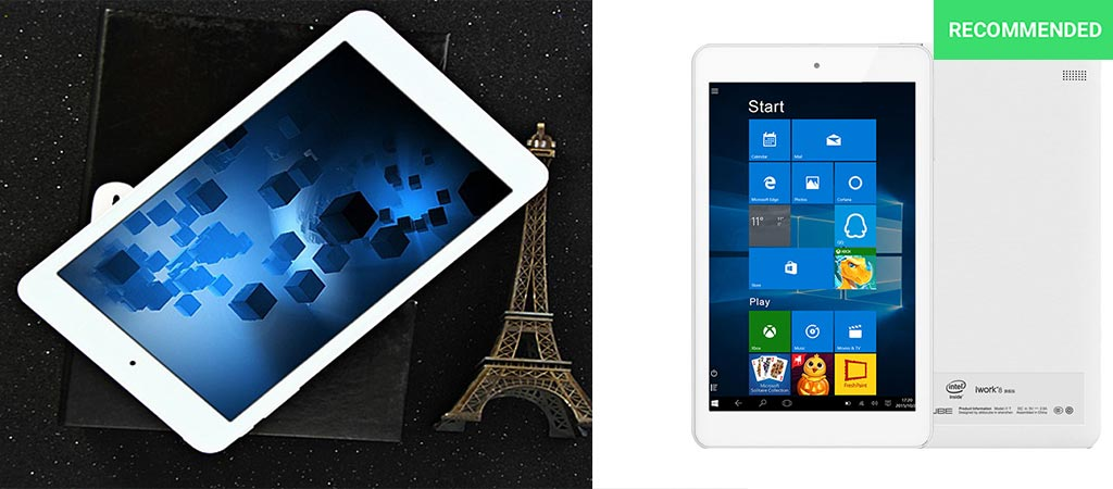 The Cube iWork8 Ultimate tablet on a book and next to a small Eiffel Tower and with a white background