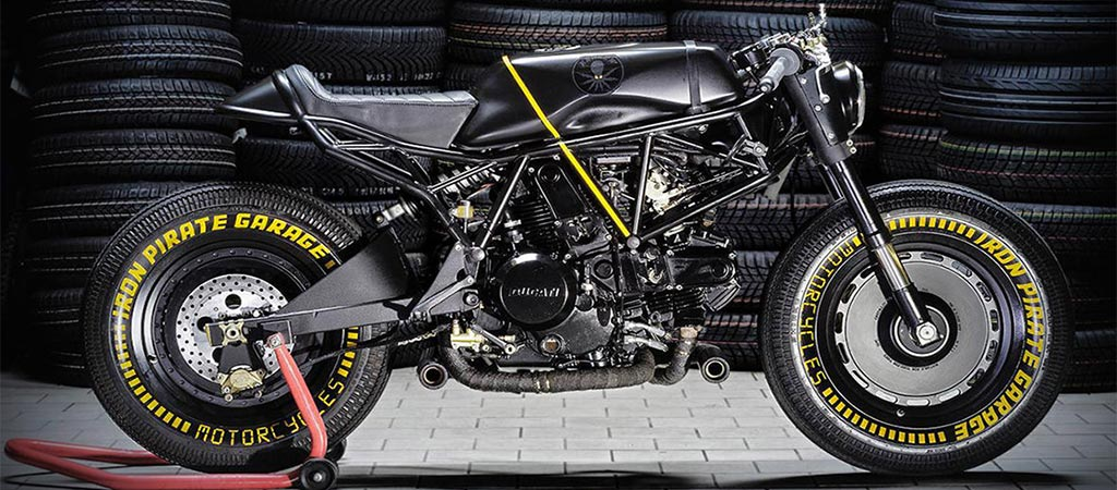 Ducati SS 750 Kraken by Iron Pirate Garage in front of tires