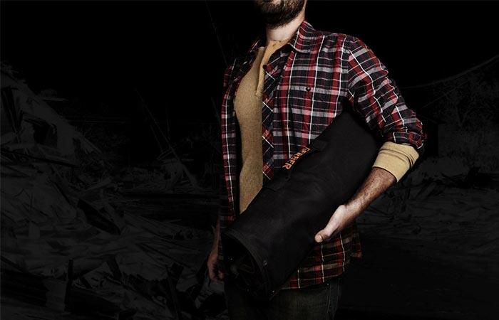 A Guy Holding Gerber Zombie Apocalypse Survival Kit