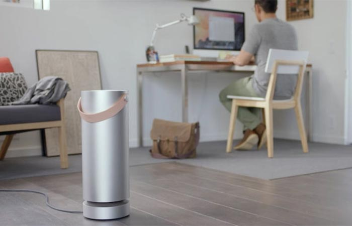 Molekule Air Purifier In A Room With A Guy Sitting At The Desk