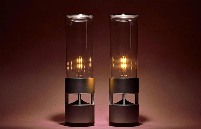 Two Sony Glass Sound Speakers Next To Each Other
