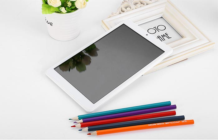 Front view of Teclast X80 Pro with book and pencils