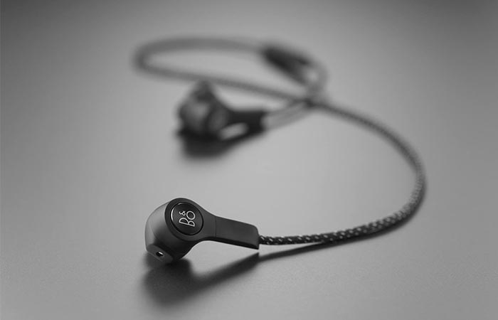 Bang & Olufsen Beoplay H5 Wireless In-Ear Headphones On A Gray Background