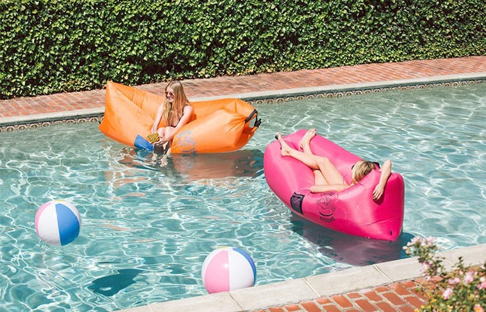 Girls using the Chillbo Baggins in a pool.