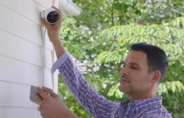 Guy installing the Nest Cam Outdoor