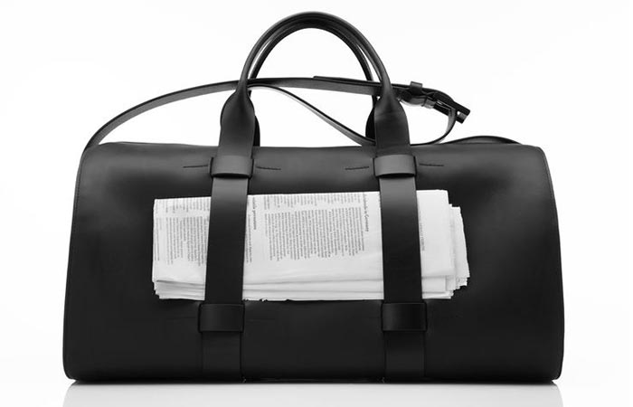 Black Troubadour Day Bag With Papers In It