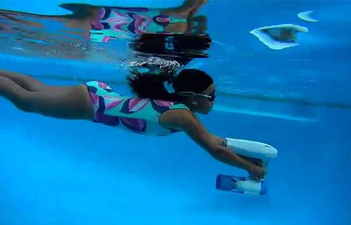 Girl using the Bixpy Swim Jet