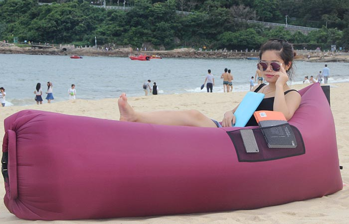 Girl using a purple BonClare inflatable lounger